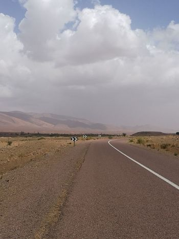 Landscape Cloud - Sky Desert Nature Outdoors Sunny Beauty In Nature Sky Day Tranquility Scenics Arid Climate The Way Forward Transportation Sand Road No People Animal Wildlife