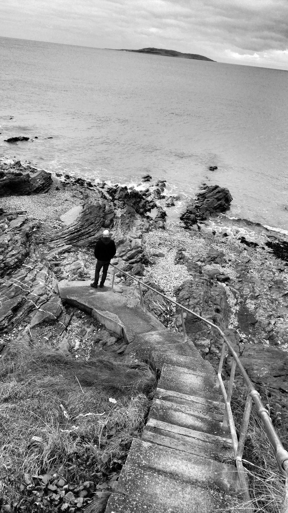 Looking at the sea Sea Beach Water Outdoors Shore Wave Day Scenics Bnw_of_our_world Bnw_europe Bnw_snapshots Bnw_collection Bnw_city Man Looking At Sea Eyem Vision EyeEm Best Shots Sky And Sea Malahide  Irelandinspires Ireland🍀 Coastal Feature Stairs Geometry Stairs To The Water Stairs To The Sea Dublin