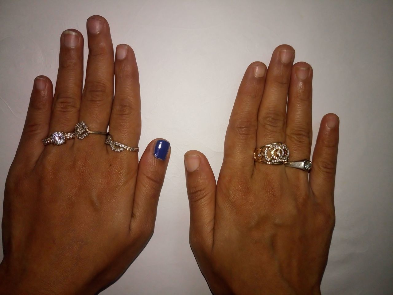 Close-Up Of Hands Wearing Rings