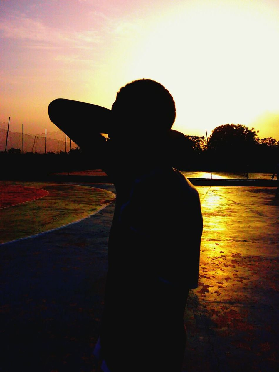 a Portrait of a Friend,more like a Sillhouette really...he told me he didnt want his face in it and this was Born... sort of represents like Rebirth... Bballcourt Evening Sunset Sunset And Clouds  Sunsetlover Sport Kwasu Kwara Nigeria