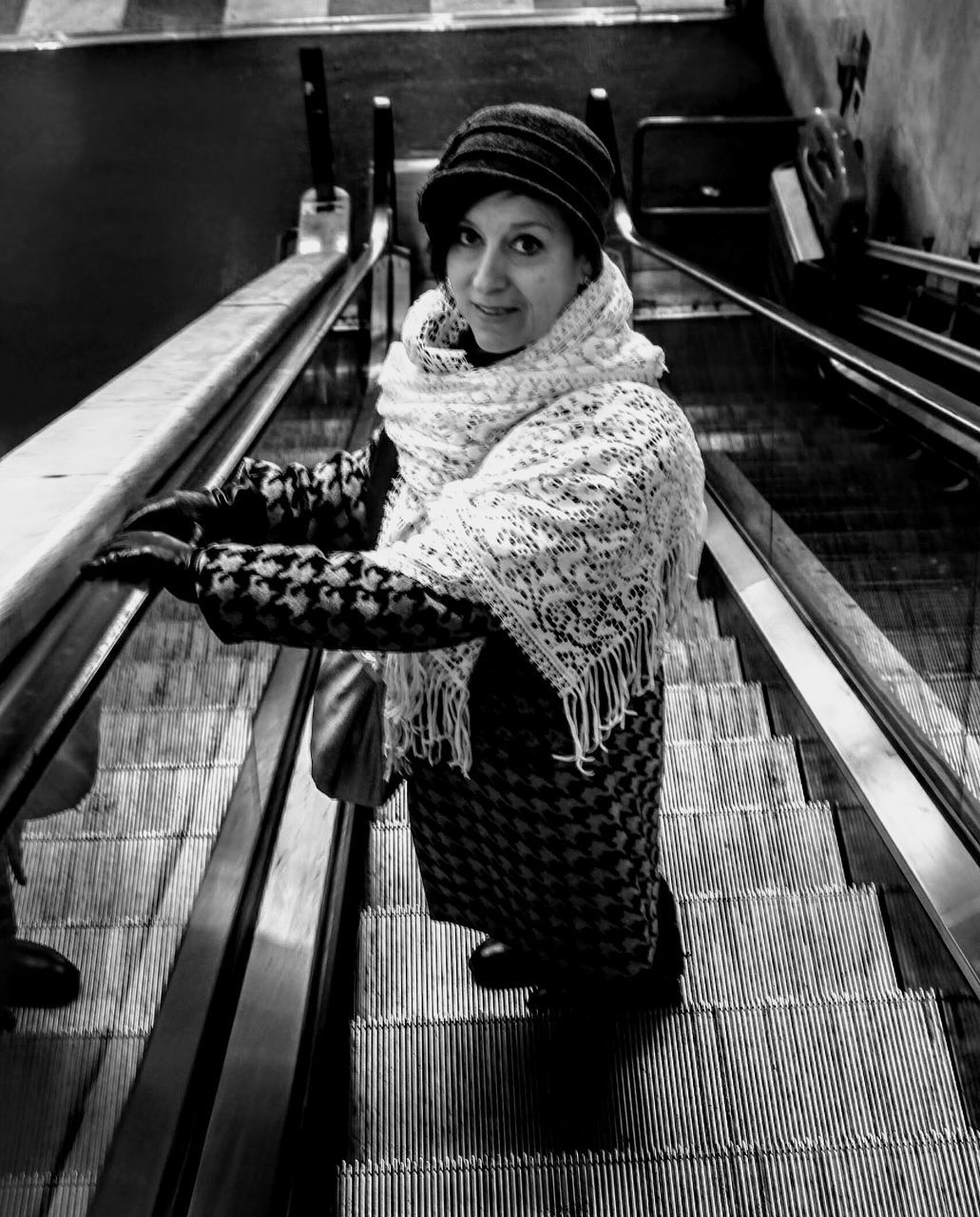 High Angle Portrait Of Woman Standing On Escalator At Firenze Santa Maria Novella Railway Station