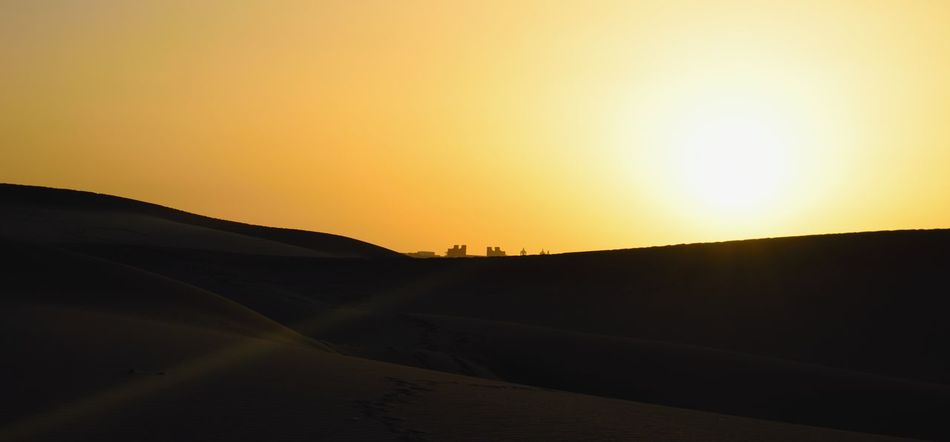 Beauty In Nature Clear Sky Day Desert Hill Landscape Nature No People Outdoors Sand Dune Scenics Silhouette Sky Sun Sunlight Sunset Tranquil Scene Tranquility Travel Destinations