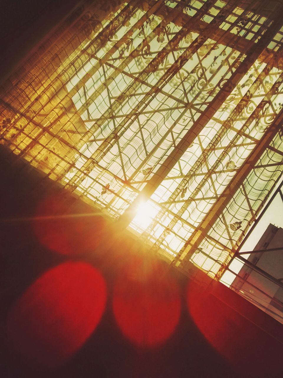 indoors, no people, sunlight, red, low angle view, day, close-up, architecture, sky