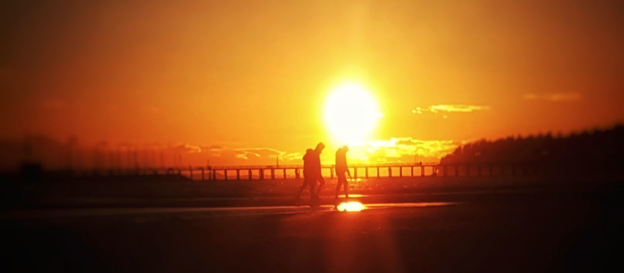 Sunset Sun Orange Color Beauty In Nature Sunlight Nature Sea Silhouette Tranquil Scene Real People Scenics Tranquility Outdoors Water Sky One Person Beach Men Only Men People Pink Color Tranquility Illuminated Dramatic Sky Beauty In Nature