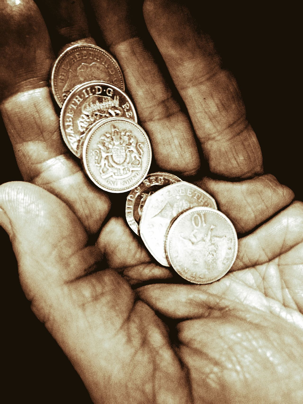 Human Hand Human Body Part Coin Currency Lifestyles Holding Close-up Adult Light And Shadow Wealth Strength Natural Lighting Fingers coins Stirling Charity donate