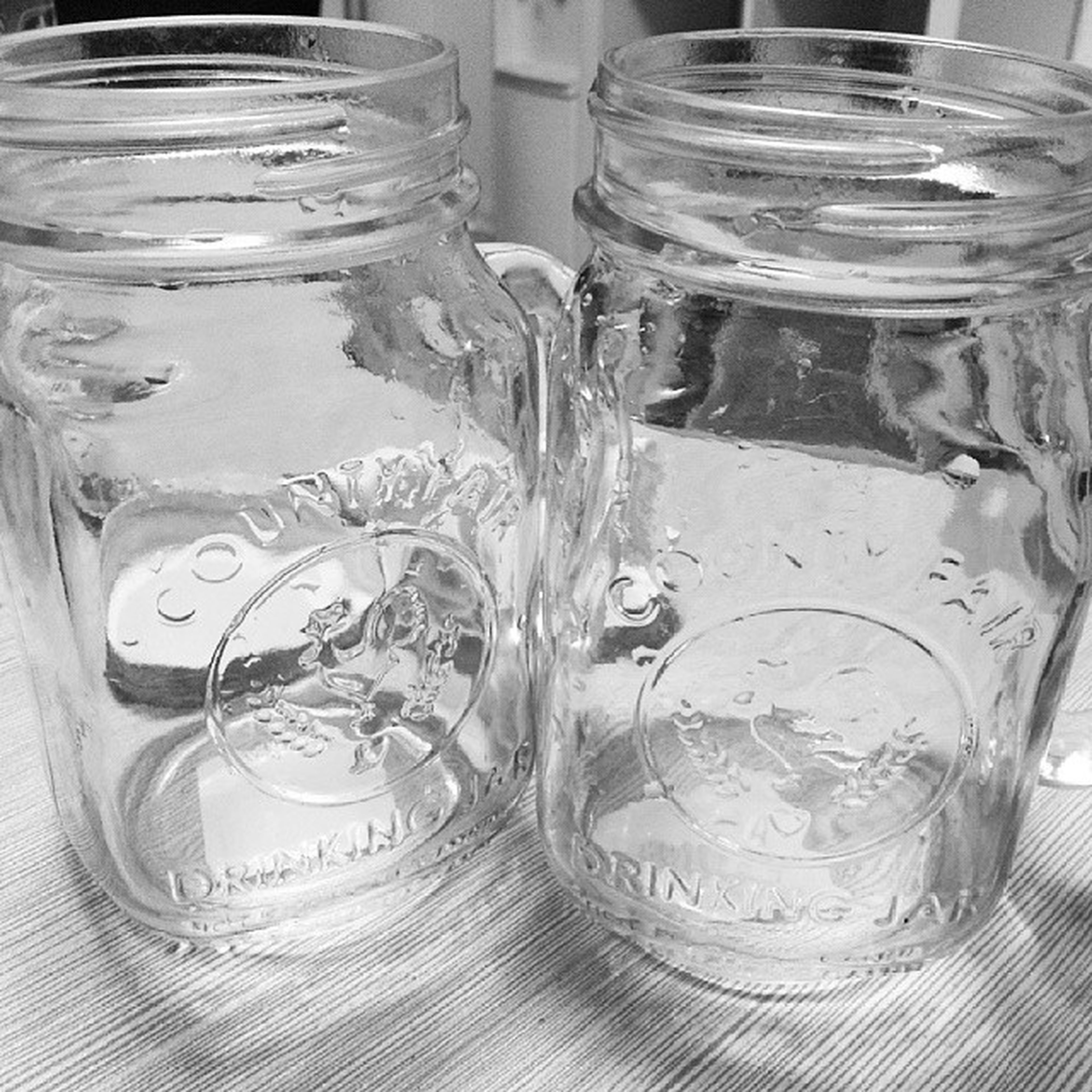 indoors, glass - material, table, drinking glass, still life, transparent, close-up, drink, food and drink, refreshment, jar, freshness, glass, reflection, no people, water, wineglass, high angle view, empty, focus on foreground