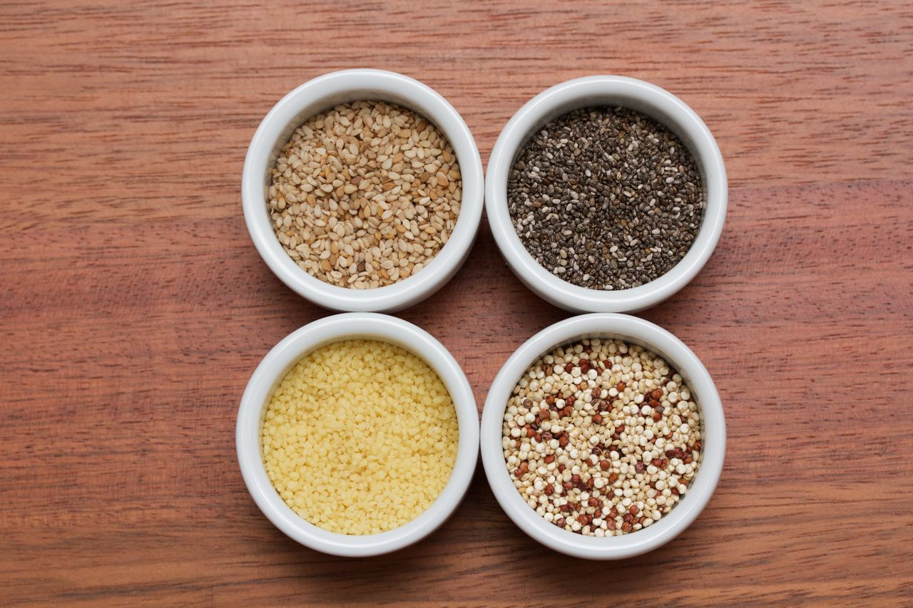 sesame seeds, chia seeds, moroccan couscous and quinoa seeds in little white bowls on a wooden table Bowl Chia Day Food And Drink Healthy Eating Moroccan Couscous No People Oats - Food Quinoa Sesame Studio Shot Table Variation