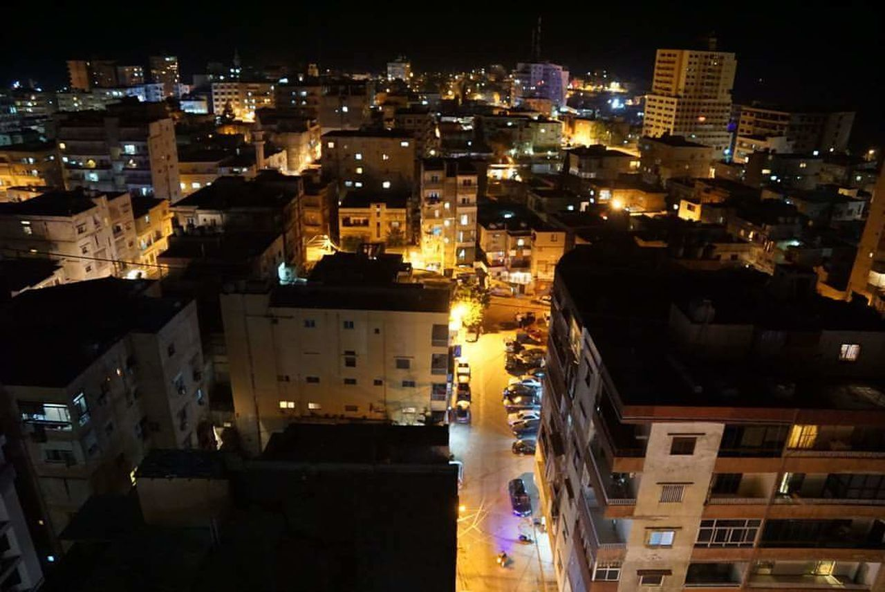 architecture, building exterior, built structure, city, illuminated, night, cityscape, no people, high angle view, residential building, town, outdoors, sky