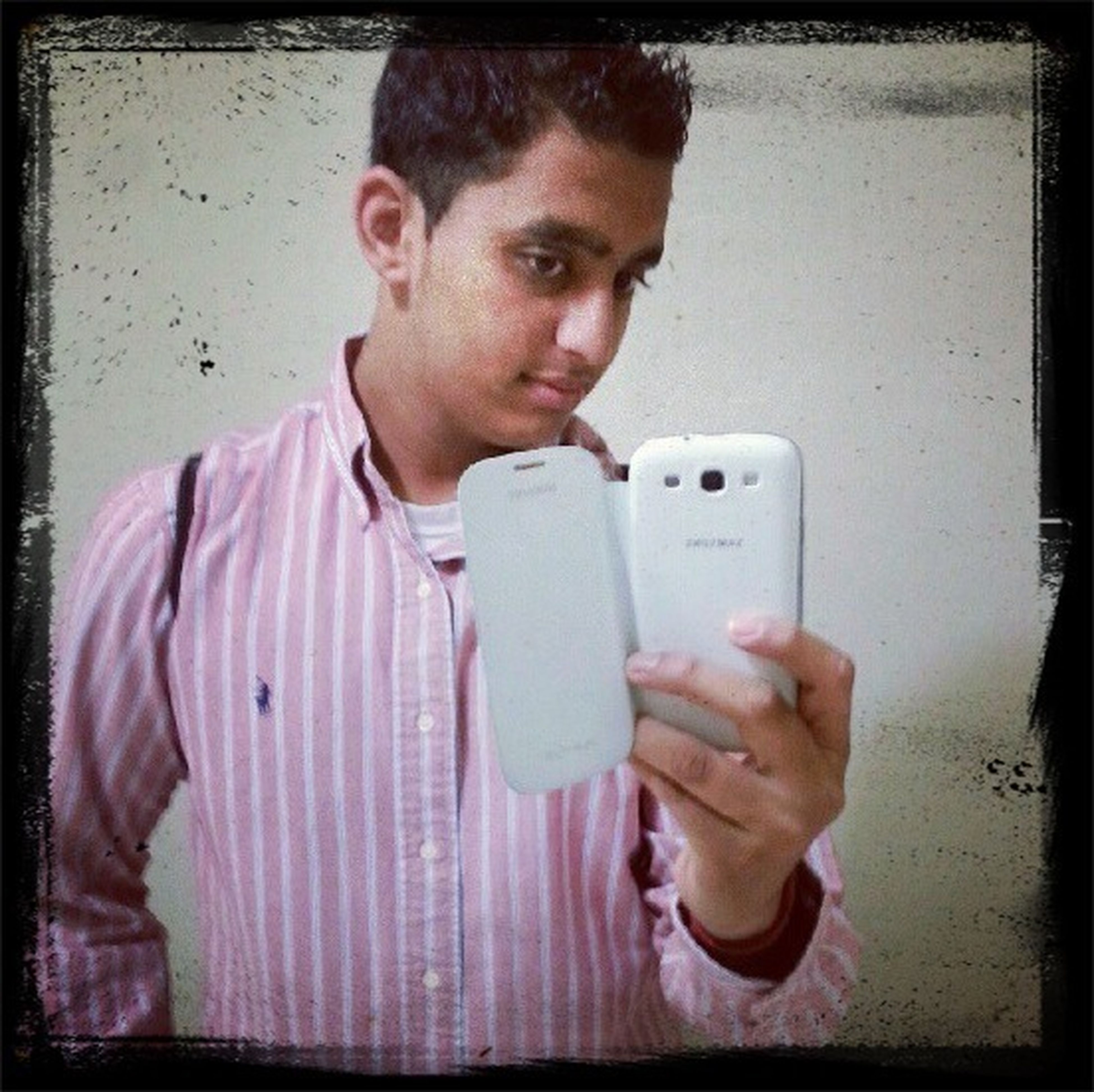 indoors, person, holding, transfer print, lifestyles, front view, casual clothing, wireless technology, leisure activity, young men, auto post production filter, childhood, communication, waist up, technology, food and drink, boys, elementary age