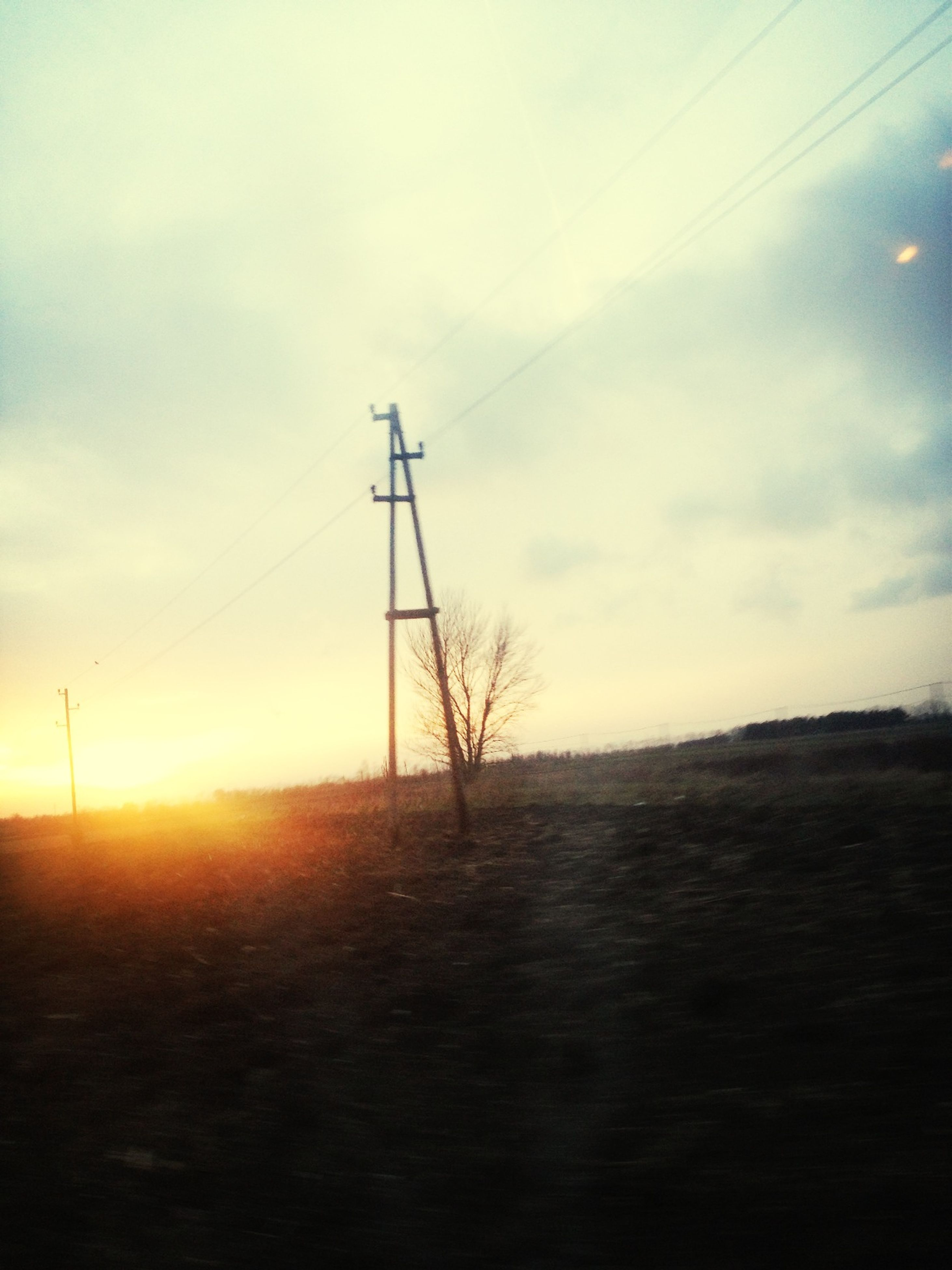 electricity pylon, power line, electricity, fuel and power generation, power supply, tranquility, sunset, tranquil scene, landscape, sky, technology, scenics, connection, field, cable, nature, beauty in nature, silhouette, sun, rural scene