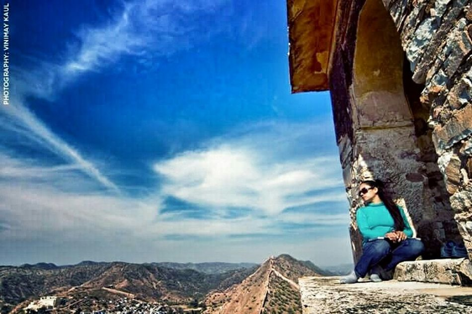 The Adventure Handbook My Wife looking at the Amer Fort Jaipur Rajasthan Incredible India Beautiful View Sky And City Letyourhairdown Thegreatoutdoorswithadobe