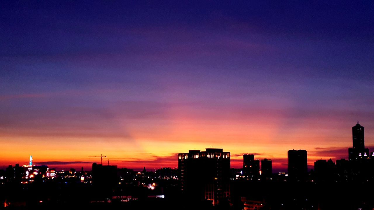 sunset, architecture, building exterior, built structure, city, cityscape, skyscraper, illuminated, sky, silhouette, no people, city life, modern, outdoors, travel destinations, urban skyline, nature