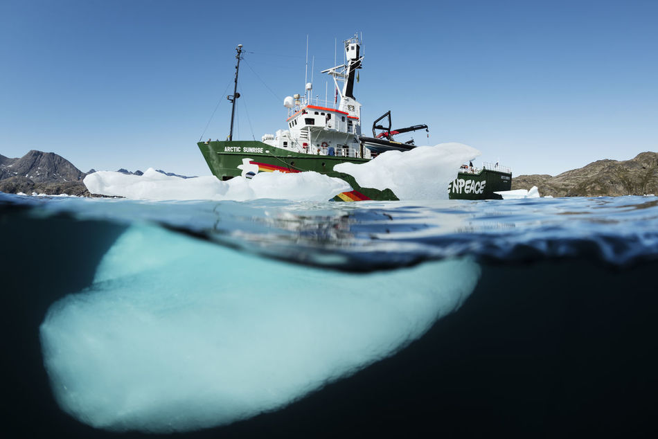 50/50 split image of Greenpeace ship the Arctic Sunrise, on the east coast of Greenland. Greenpeace is working in the area to highlight the exploration by the oil companies. Temperatures rise faster in the Arctic than anywhere else, and while scientists are warning of the mounting risks of climate change, the oil industry regards the decline of sea ice as a new business opportunity. Greenpeace Greenland SaveTheArctic Arctic Underwater Capture The Moment Seascape Climatechange Ocean Environment Ice Age