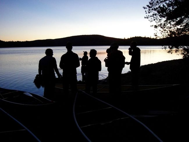 Algonquin Algonquin Park Algonquinprovincialpark Beauty In Nature Boat Deck Camping Clear Sky Dusk Fishing Friendship Leisure Activity Men Nature People Real People Silhouette Sky Standing Sunset Sunset Silhouettes Sunset_collection Sunsets Water