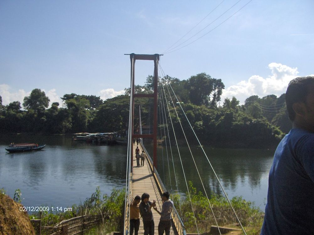 Hanging Bridge Rangamati. It's a beautiful tourism place in Bangladesh Beauty In Nature Blue Sky Clear Sky Clouds And Sky Hanging Bridge Lake View Lakeshore Lakeside Nature Nature Photography Sky Structure And Nature Tree Water