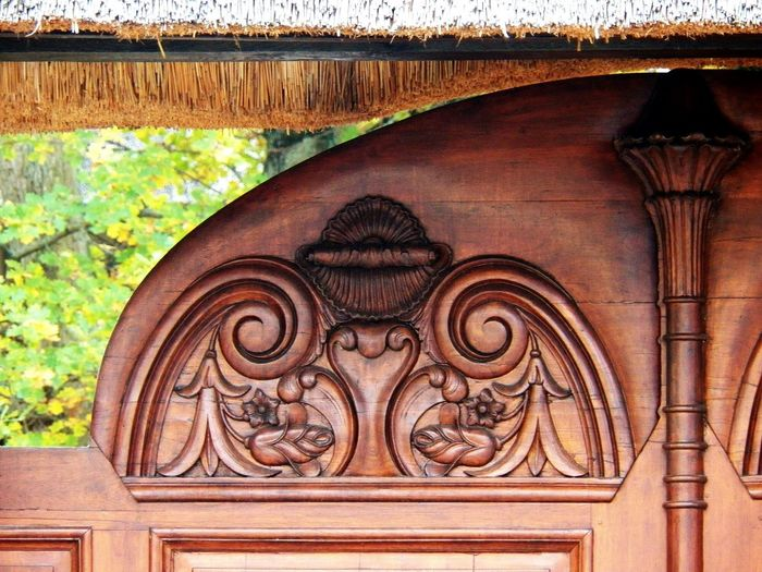 Ornate Detail Of Wood Close-up Portal Portail Ornement -In France