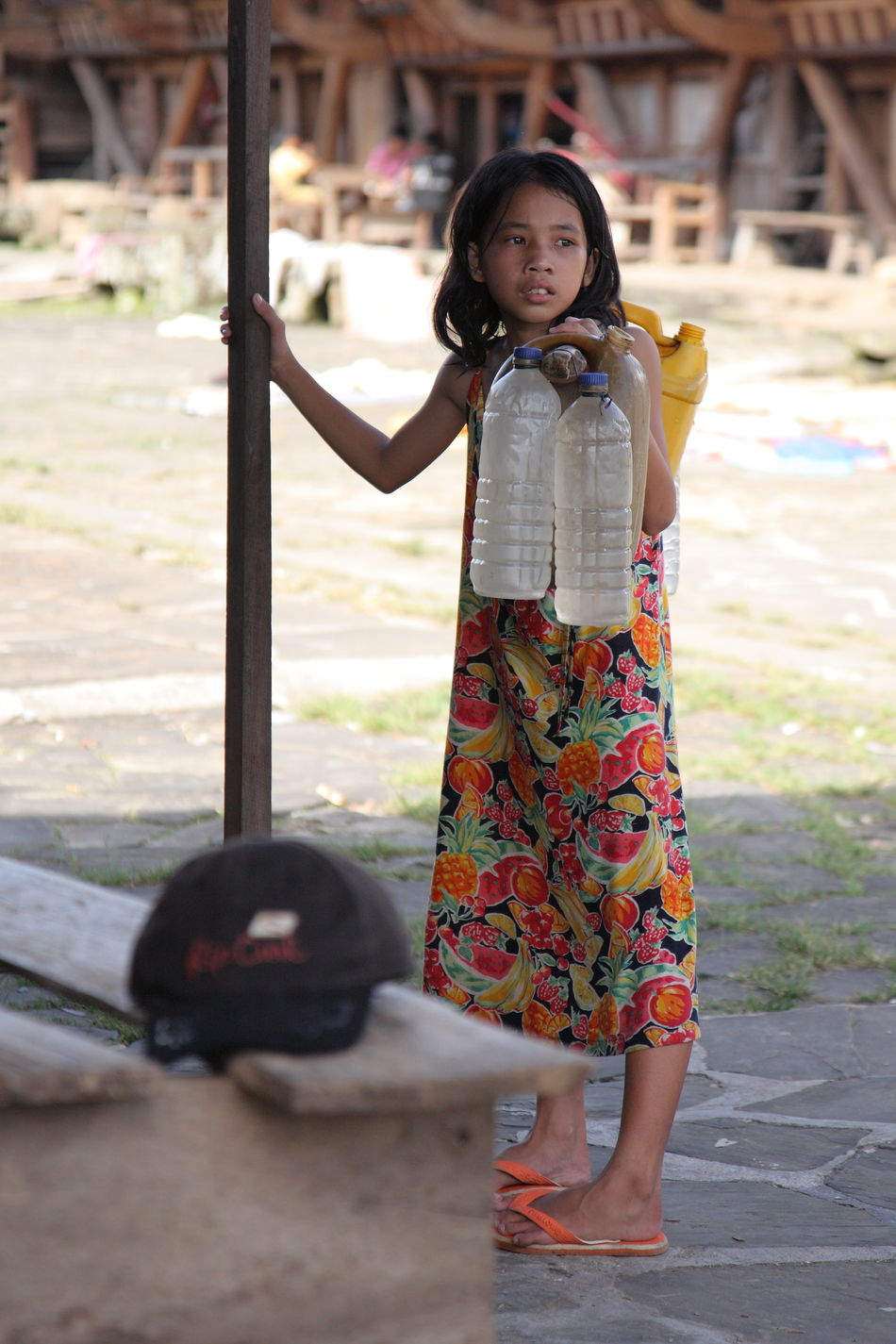 Uniqueness Child One Girl Only Children Only Childhood Outdoors Child Worker Carrying Water  Traditional Culture Real People Nias Island INDONESIA Miles Away