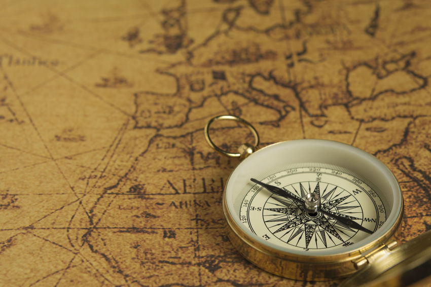 Golden compass on an old map Antique Decisions Golden Map Obsolete Old Fashioned Treasure Adventure Backgrounds Brass Close Up Compass Concept Destination Direction Discovery Exploration Explore Guidance Journey Navigation Old Searching Seeking Vintage