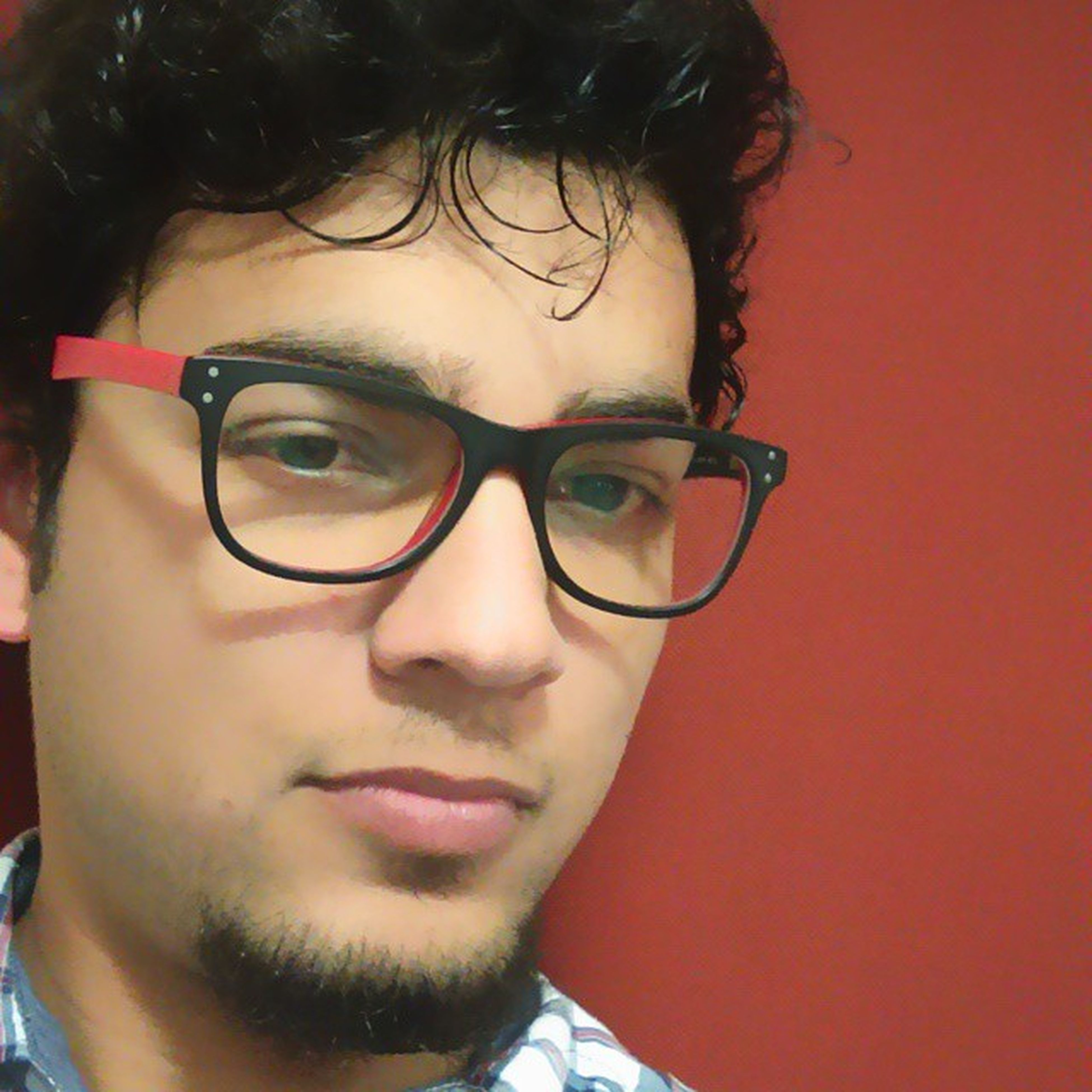 looking at camera, portrait, young adult, person, headshot, lifestyles, front view, leisure activity, sunglasses, smiling, young men, close-up, casual clothing, head and shoulders, mid adult, human face, indoors