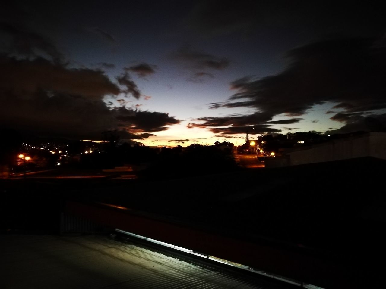 sky, sunset, transportation, silhouette, city, illuminated, no people, night, outdoors, nature, cloud - sky, building exterior, road, architecture