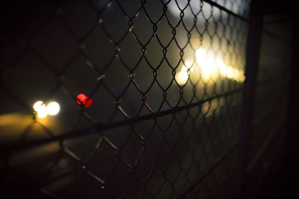Burning Chainlink Fence Close-up Dark Illuminated Night No People Nurburgring Outdoors Protection Race Safety Sunset