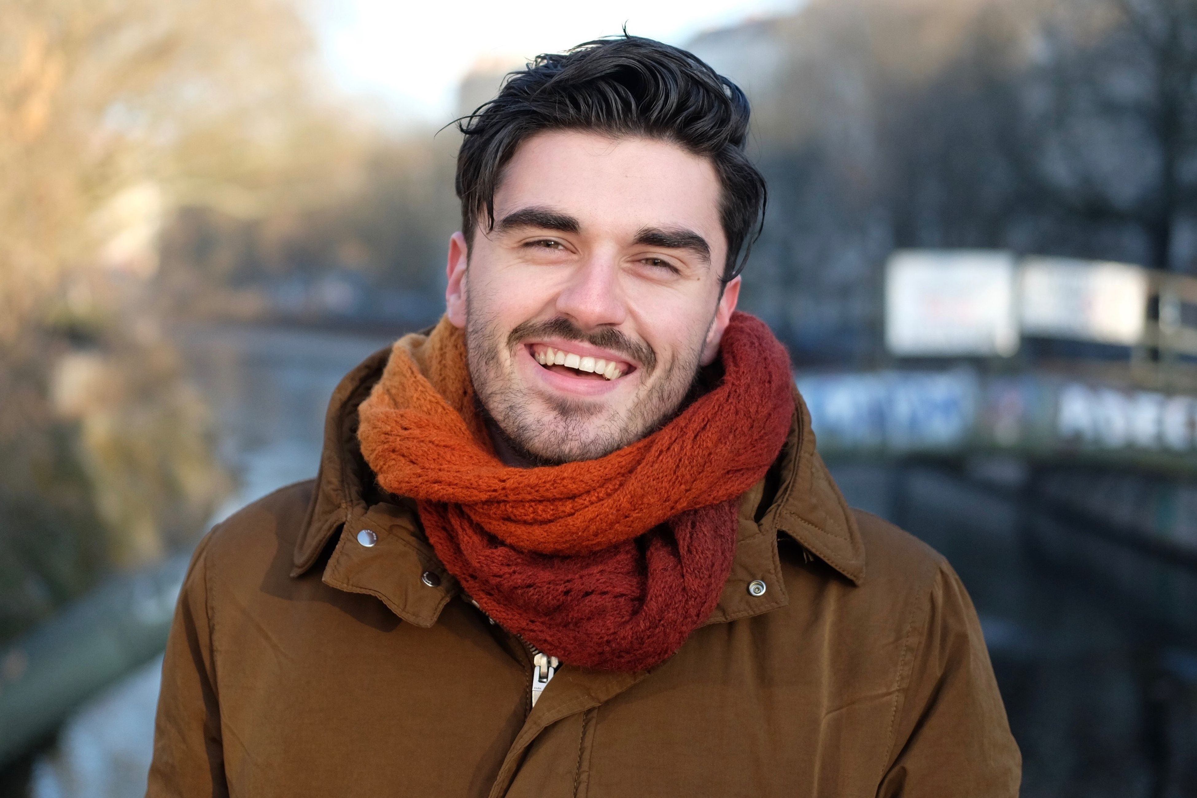 portrait, winter, headshot, one person, looking at camera, front view, only men, young adult, warm clothing, lifestyles, smiling, men, scarf, one man only, leisure activity, beard, adult, adults only, people, outdoors, cheerful, happiness, close-up, day