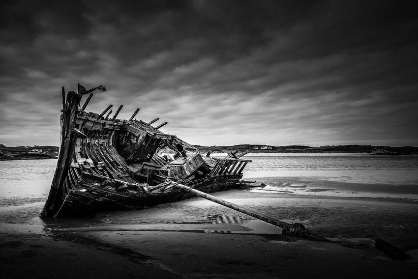 Bad Eddie at Bunbeg Donegal, in monochrome Blackandwhite Cloud - Sky Cloudy Landscape Maritime Marítim Monochrome Nature No People Non-urban Scene Outdoors Scenics Shipwreck Sky Tranquil Scene Tranquility Water Weather Wood - Material