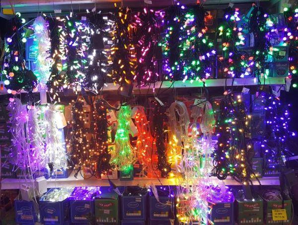 Hanging EyeEmNewHere EyEmNewHere Eyeem Market Eyem Market Shop Shop Shelves Christmas Lights Christmasmarket Colourful Lights Christmas Sales Illuminated Night Multi Colored Celebration No People EyeEm Ready