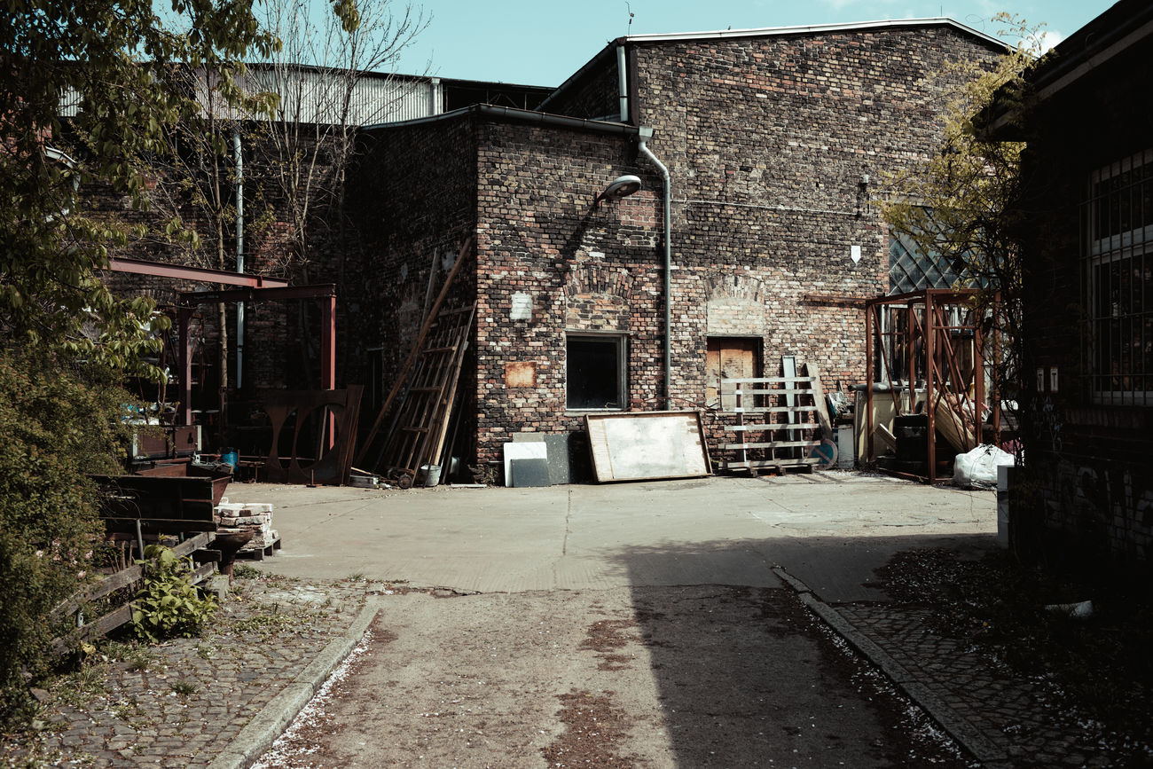 A creative commune at old railway yard Abandoned Architecture Berlin Photography Berliner Ansichten Building Exterior Built Structure Day House No People Old Buildings Outdoors Railway Yards Street Street Photography Streetphotography Sunlight The Photojournalist - 2017 EyeEm Awards Tree Urban Urban Development Urban Geometry Yard