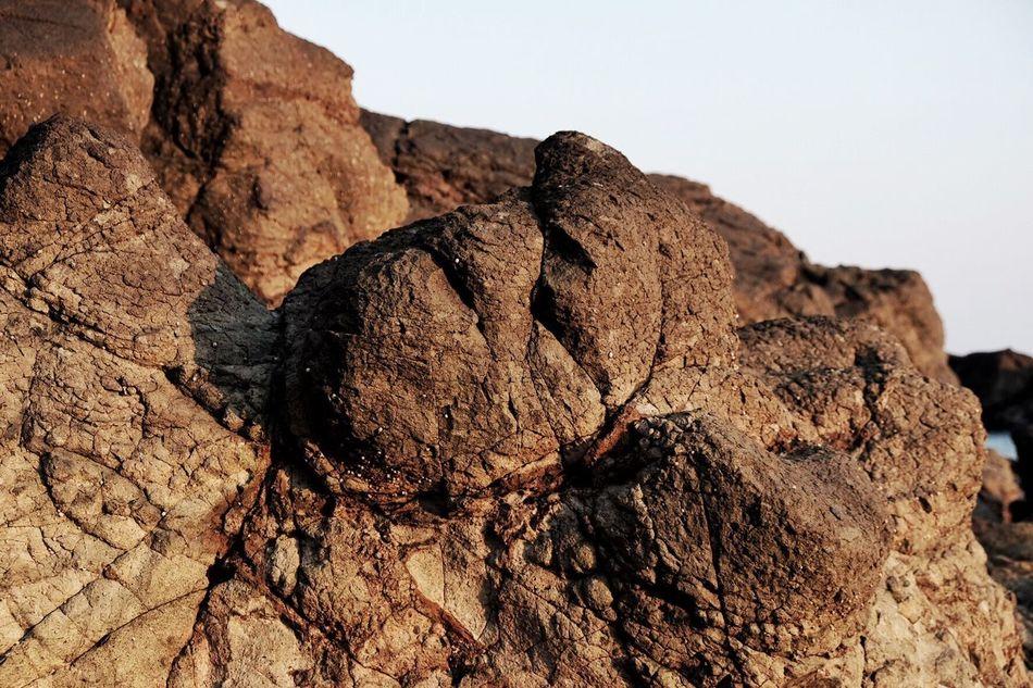 クチャおじさん✨ Rock - Object Geology Nature Rock Formation Textured  Outdoors Brown Day Physical Geography Arid Climate Beauty In Nature Close-up Sky EyeEm Nature Lover Life Is A Beach My Point Of View Beach Eye4photography  Art Is Everywhere