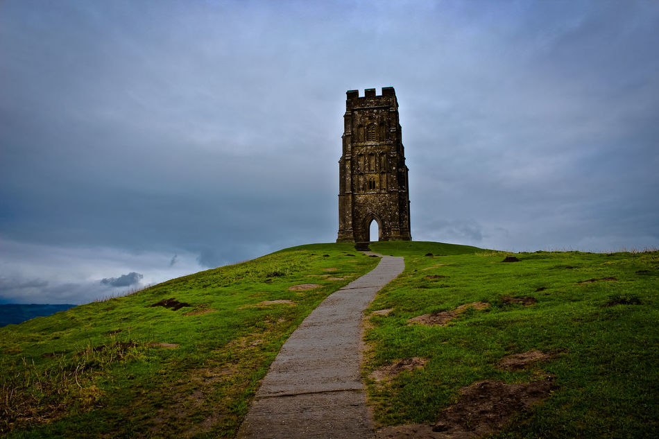 Glastonbury Tor Architecture Beauty In Nature Cloud - Sky Day Glastonbury Glastonbury Tor Grass Green Color Landscape Nature No People Outdoors Sky Travel Destinations War