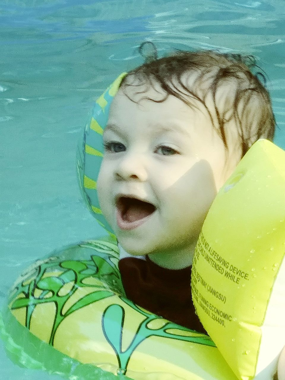 swimming pool, childhood, one person, baby, innocence, water, real people, babyhood, day, cute, outdoors, close-up