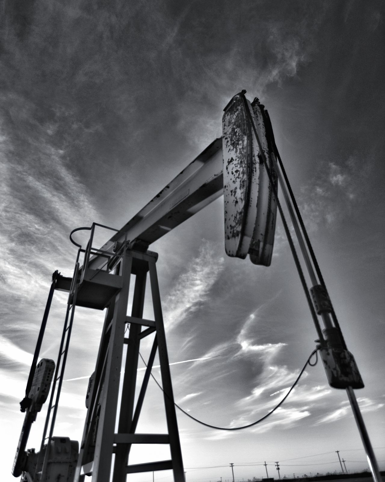 Low Angle View Fuel And Power Generation Drilling Rig Sky No People Oil Pump Outdoors Manufacturing Equipment Oil Field Nature Day Black And White Collection! EyeEm Gallery Eyeemphotography Texas Photographer This Week On Eyeem Dramatic Sky Low Angle View Wideangle Lens