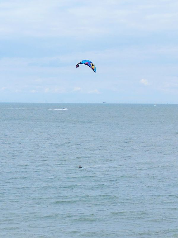 Brave Kitesurfing Flying Nature Sea Mid-air Leisure Activity Water Beauty In Nature Outdoors Sky One Person Day Stunt Person Adult Ocean Going Vessel Leisure Craft Speedboat Boat Wake