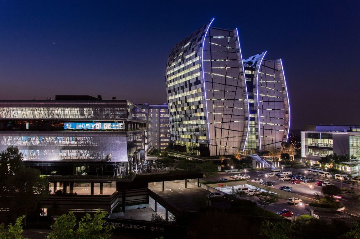 Architecture Built Structure Building Exterior City Clear Sky Tall - High Illuminated Office Building Modern Sky Outdoors Urban Skyline After Sunset Parking Space Office Buildings Enjoying Life Taking Photos Sandton South Africa Lights Norton Rose Absa Bank Of China