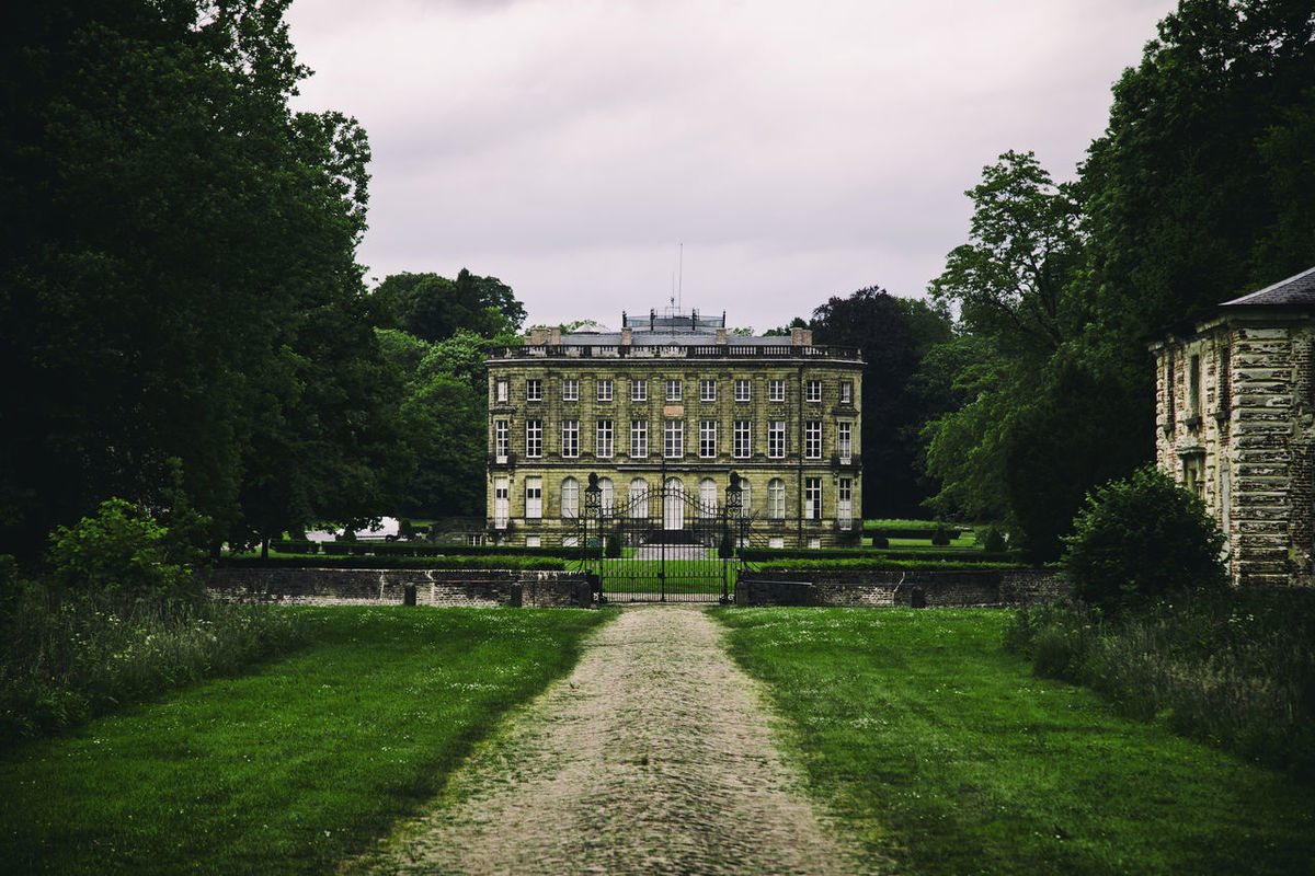 Chateau, big house castle in French isolated and surrounded by big green garden BIG Castle Château Cloudy Sky Entrance Europe France Garden Green House Invited Isolated Luxury Path Private Property Real Estate Renaissance Season  Sky Trees Visite Way Symmetry