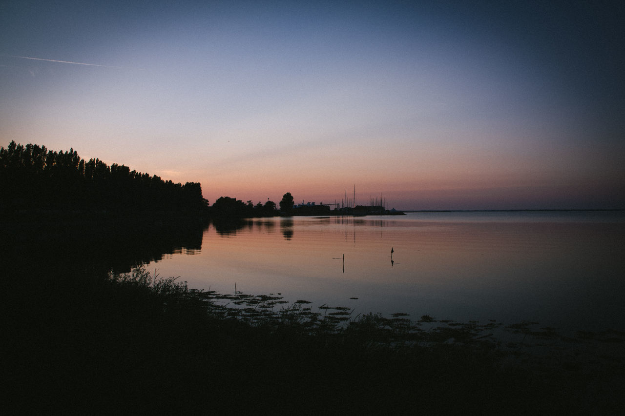 Beauty In Nature Clear Sky Dusk Nature No People Outdoors Reflection Scenics Silhouette Sky Sunset Sunset Silhouettes Tranquil Scene Tranquility Tranquility Travel Destinations Water