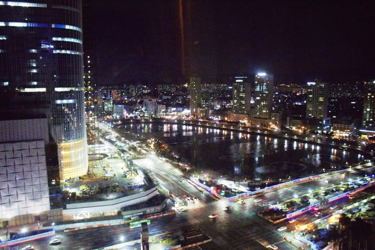 night, illuminated, city, architecture, cityscape, building exterior, built structure, skyscraper, motion, speed, transportation, modern, light trail, road, city life, urban scene, no people, high street, outdoors