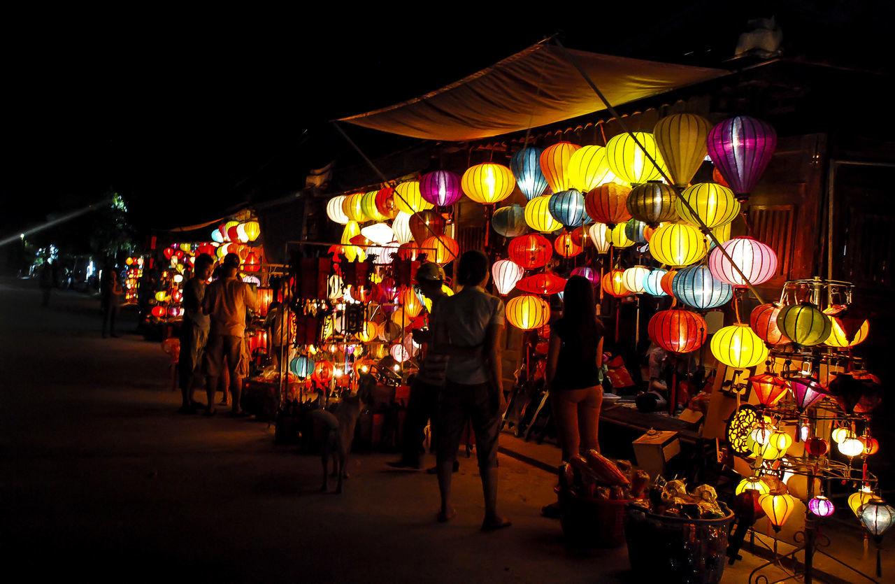 Built Structure Celebration Chinese Lantern City Cultures Hoi An Illuminated Lantern Lighting Equipment Night Outdoors Paper Lantern People Vietnam Women