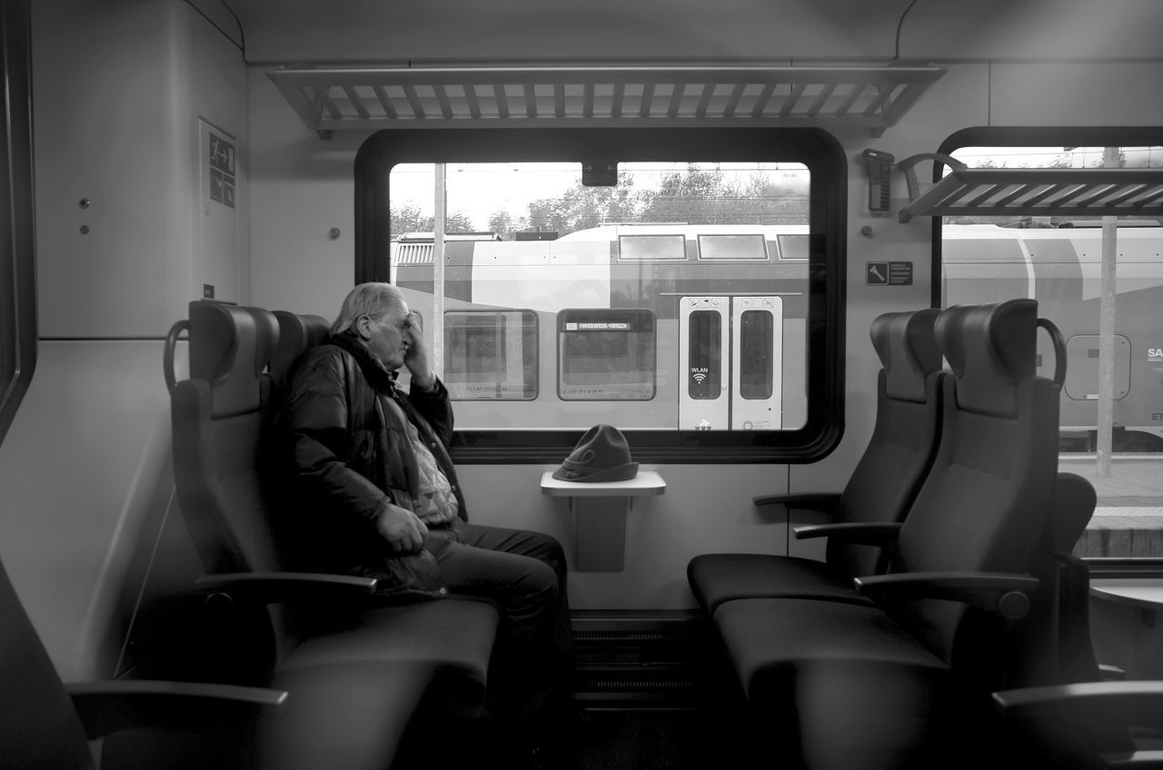 DAMN! City Life Damn Everyday Lives Forgetting Interior Views Man Monochrome Photography Old Man On The Move On The Train Passenger Person Public Transportation Real People Regret Seat Sitting Streetphotography Train Train Interior Trainstation Transportation The Drive Vehicle Interior Vehicle Seat