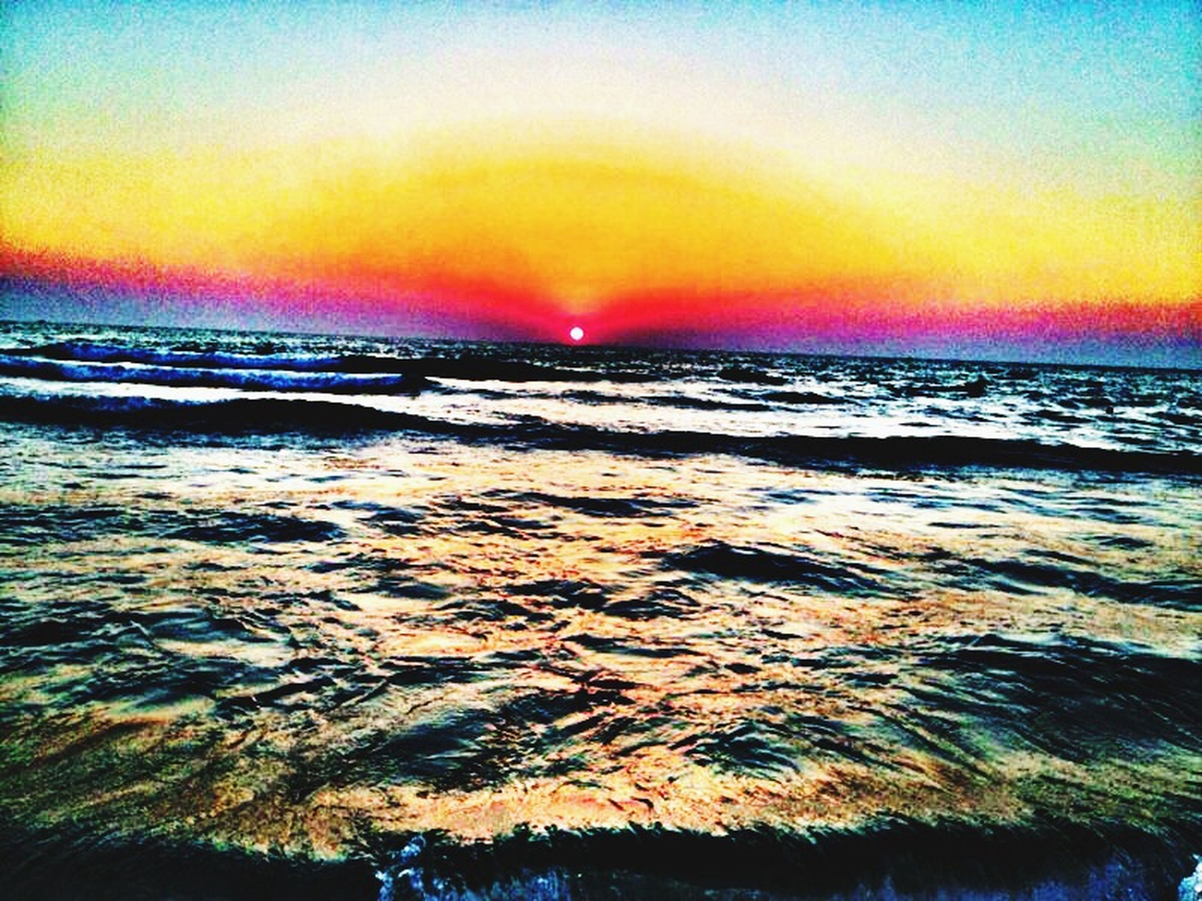 sunset, water, orange color, sea, scenics, beauty in nature, tranquil scene, tranquility, sky, horizon over water, idyllic, nature, wave, beach, sun, reflection, waterfront, outdoors, motion, non-urban scene