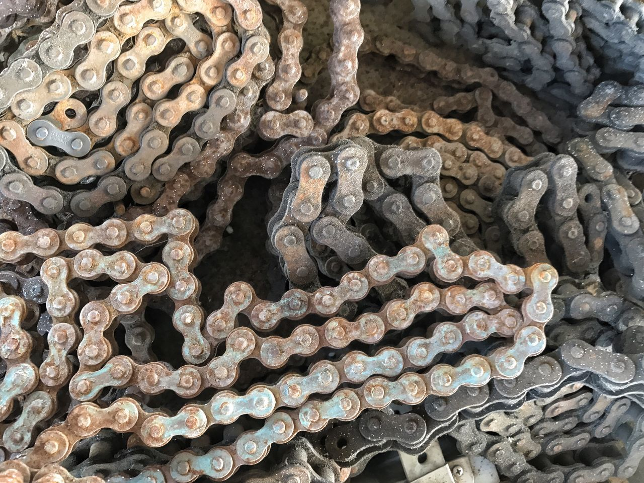 Rusty chain for a potato harvester. Chain Long Large Group Of Objects Metal Rust Full Frame No People Sprocket Close-up Backgrounds Farm Farm Life Rural Scene Machinery Potato Farm Equipment Links Linked