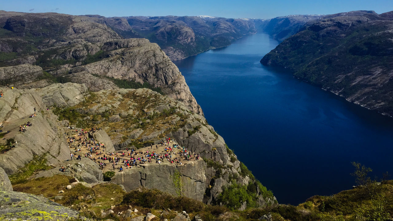 The Preikestolen in Norway Beauty In Nature Day High Angle View Mountain Nature Outdoors People Physical Geography Preikestolen Pulpit Rock River Rock - Object Scenics Sky Tourism Tranquil Scene Tranquility Water The Great Outdoors - 2017 EyeEm Awards