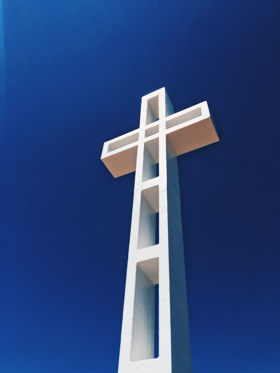 blue, low angle view, cross, clear sky, no people, day, outdoors, sky