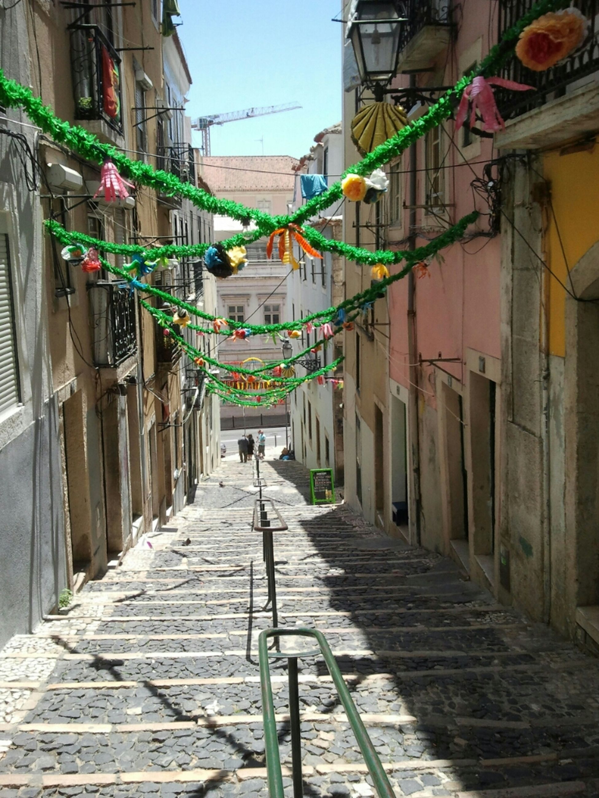 architecture, building exterior, built structure, the way forward, diminishing perspective, vanishing point, alley, residential structure, residential building, narrow, walking, cobblestone, street, house, sky, men, city, incidental people, walkway