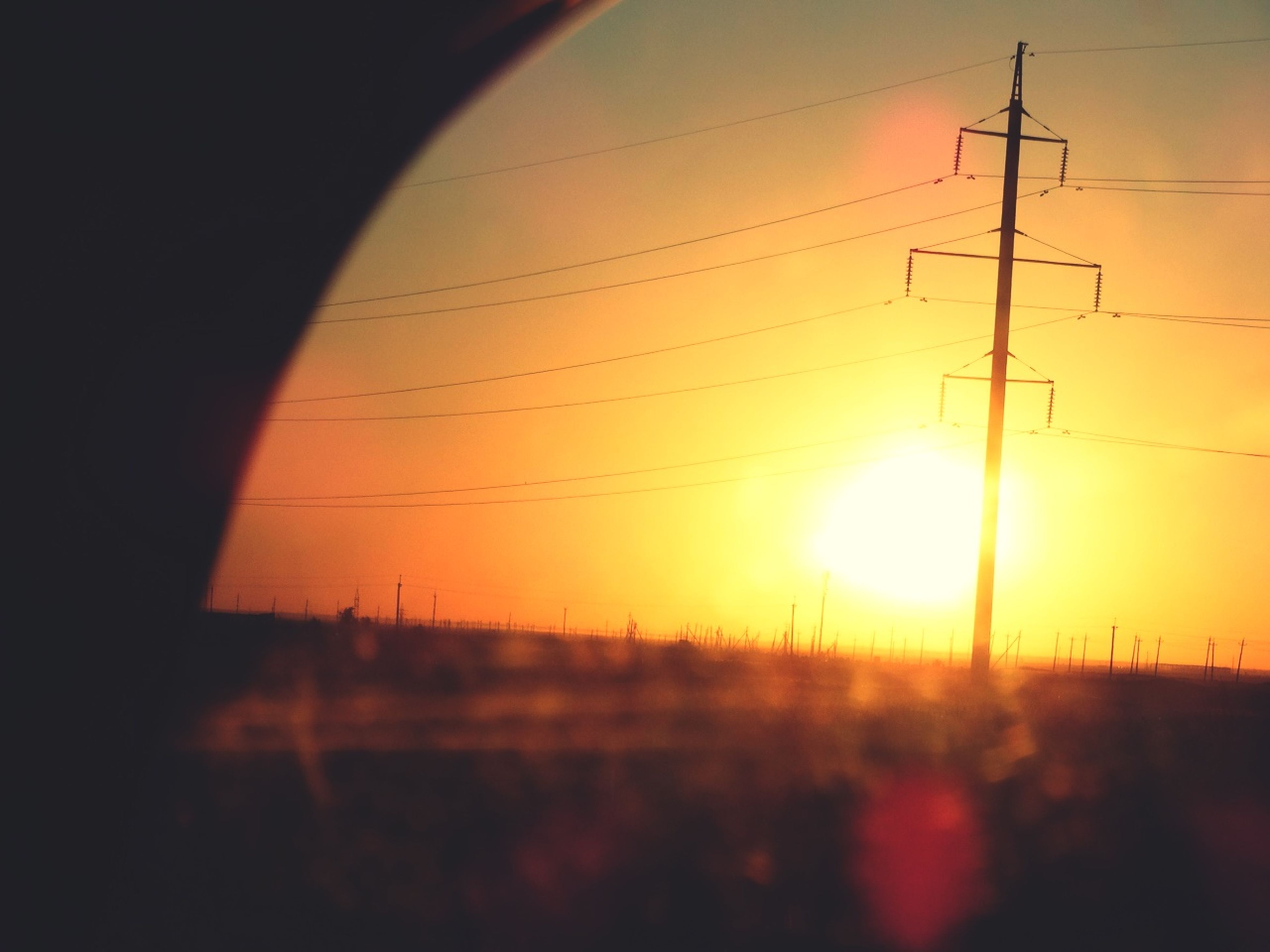 sunset, power line, electricity pylon, power supply, electricity, sun, fuel and power generation, cable, connection, silhouette, technology, sky, orange color, power cable, landscape, sunlight, tranquility, nature, scenics, beauty in nature