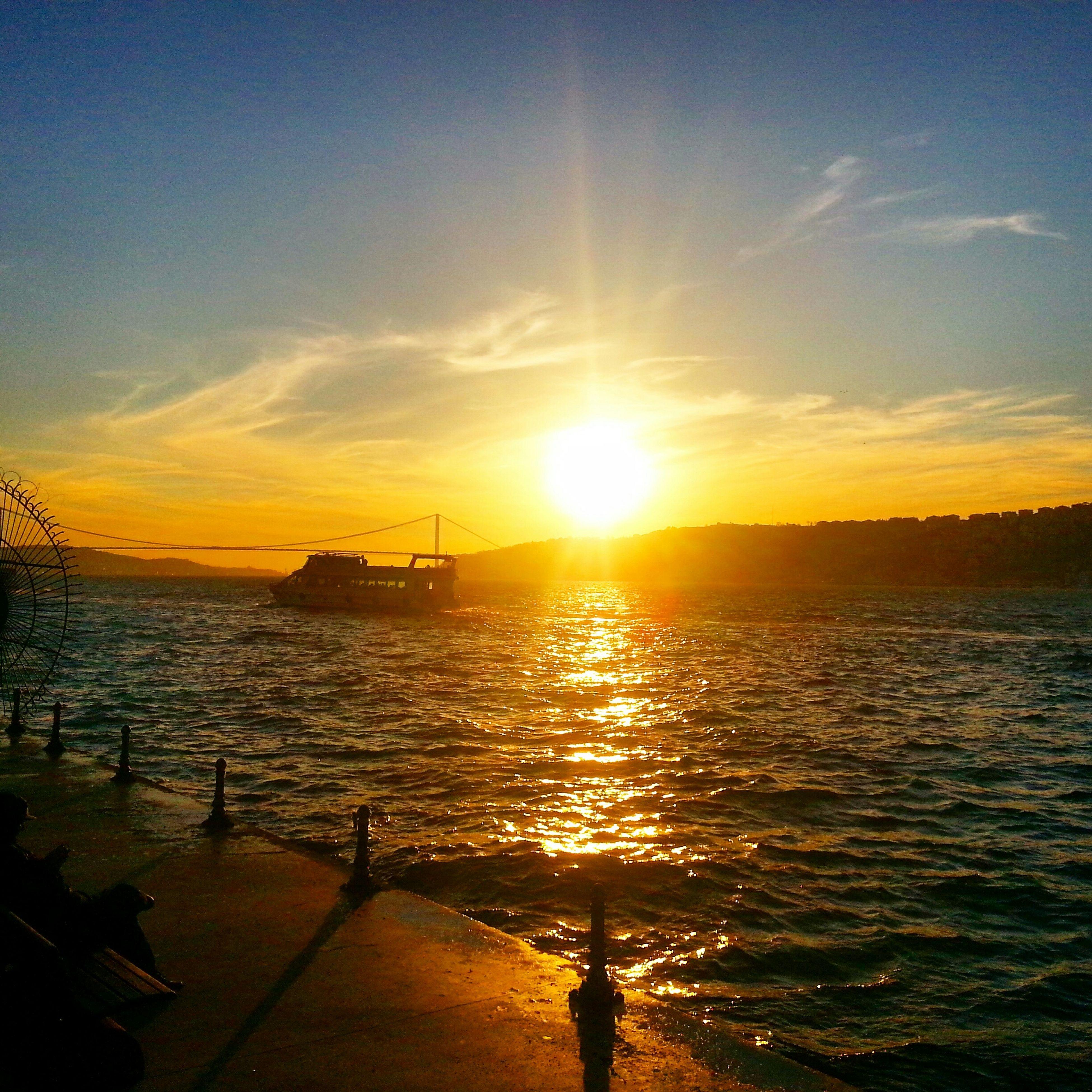 sunset, sun, water, sea, sky, transportation, sunlight, nautical vessel, scenics, horizon over water, beauty in nature, tranquil scene, mode of transport, tranquility, sunbeam, orange color, nature, boat, reflection, idyllic