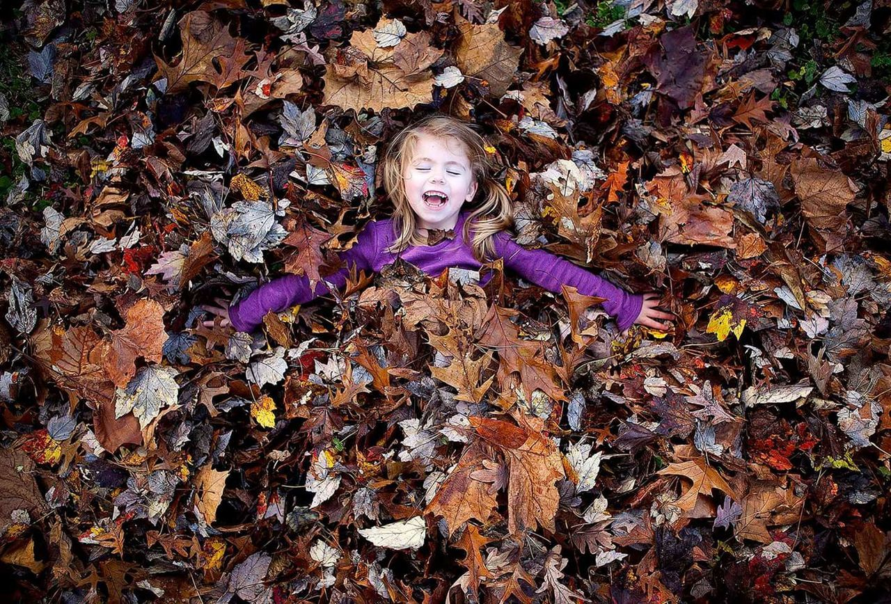 My daughter enjoying a pile of Colorful Autumn Leaves. Pattern, Texture, Shape And Form Nature Happiness Autumn Colors Autumn Authentic Moments Child Children Photography Not Posed Capture The Moment Canon 24-70 Home Is Where The Art Is