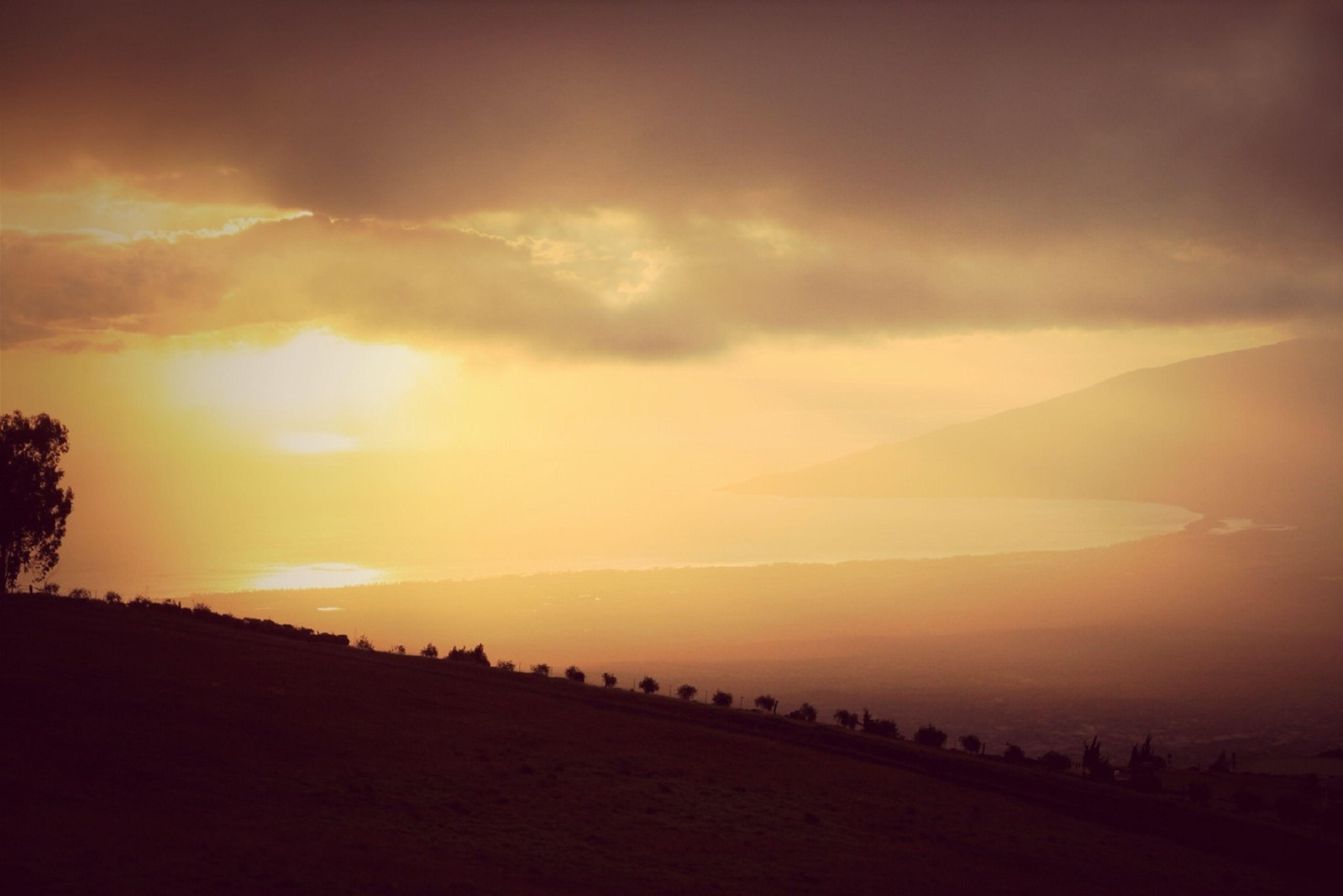 sunset, tranquil scene, scenics, silhouette, tranquility, sky, beauty in nature, landscape, orange color, nature, idyllic, cloud - sky, non-urban scene, cloud, horizon over land, outdoors, sun, mountain, remote, sunlight