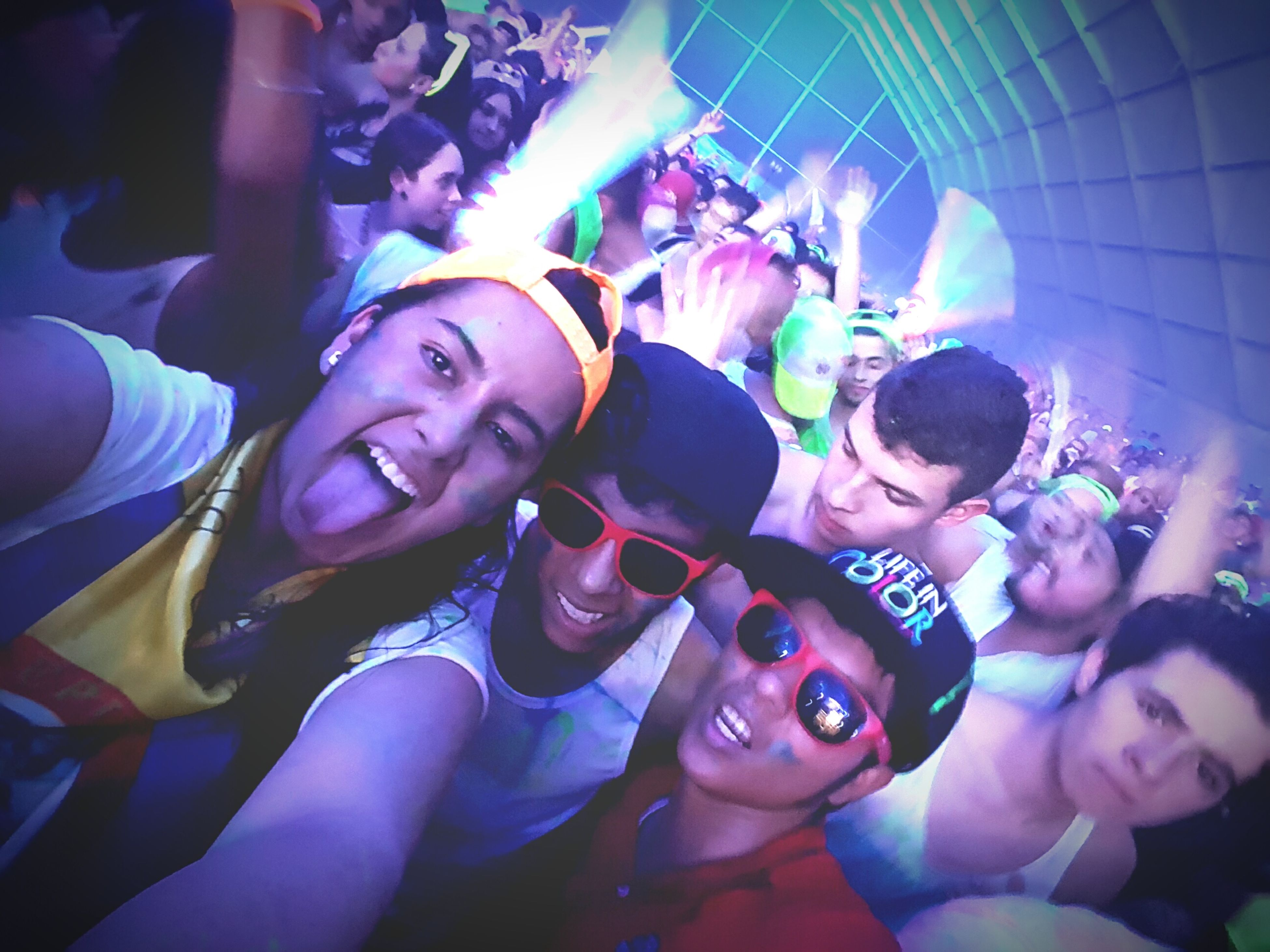 indoors, lifestyles, leisure activity, enjoyment, fun, illuminated, arts culture and entertainment, person, celebration, happiness, large group of people, togetherness, event, portrait, performance, night, nightlife, youth culture, casual clothing